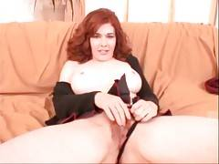 Awesome redhead milf Mae Victoria shows all her charms.